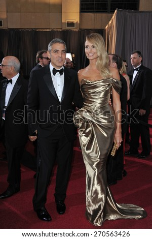 LOS ANGELES, CA - FEBRUARY 26, 2012: George Clooney & Stacy Keibler at the 84th Annual Academy Awards at the Hollywood & Highland Theatre, Hollywood.