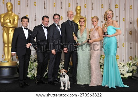 LOS ANGELES, CA - FEBRUARY 26, 2012: Jean Dujardin, Berenice Bejo, James Cromwell, Penelope Ann Miller, Missi Pyle, directer Michel Hazanavicius & Thomas Langmann - at the 82nd Academy Awards  - stock photo