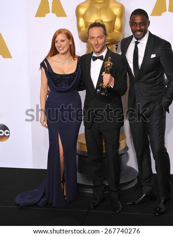 LOS ANGELES, CA - FEBRUARY 22, 2015: Jessica Chastain & Emmanuel Lubezki & Idris Elba at the 87th Annual Academy Awards at the Dolby Theatre, Hollywood.  - stock photo