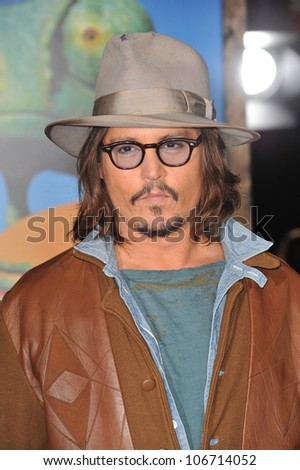 """LOS ANGELES, CA - FEBRUARY 14, 2011: Johnny Depp at the Los Angeles premiere of his new animated movie """"Rango"""" at the Regency Village Theatre, Westwood. February 14, 2011  Los Angeles, CA - stock photo"""