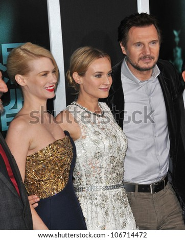 """LOS ANGELES, CA - FEBRUARY 16, 2011: Liam Neeson, January Jones (left) & Diane Kruger at the premiere of """"Unknown"""" at the Mann Village Theatre, Westwood. February 16, 2011  Los Angeles, CA - stock photo"""