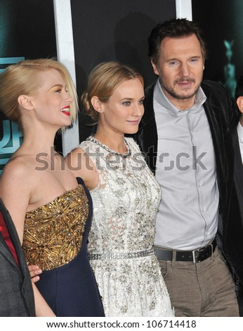 "LOS ANGELES, CA - FEBRUARY 16, 2011: Liam Neeson with January Jones (left) & Diane Kruger at the premiere of ""Unknown"" at the Mann Village Theatre, Westwood. February 16, 2011  Los Angeles, CA"