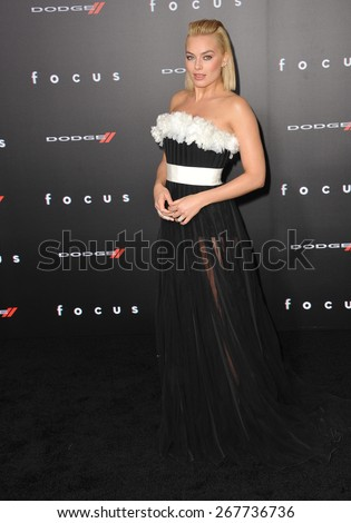 """LOS ANGELES, CA - FEBRUARY 24, 2015: Margot Robbie at the Los Angeles premiere of her movie """"Focus"""" at the TCL Chinese Theatre, Hollywood.  - stock photo"""