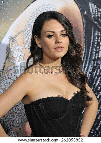"""LOS ANGELES, CA - FEBRUARY 2, 2015: Mila Kunis at the Los Angeles premiere of her movie """"Jupiter Ascending"""" at the TCL Chinese Theatre, Hollywood.  - stock photo"""