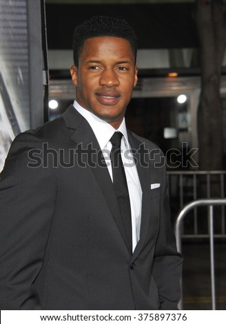 "LOS ANGELES, CA - FEBRUARY 24, 2014: Nate Parker at the world premiere of his movie ""Non-Stop"" at the Regency Village Theatre, Westwood."