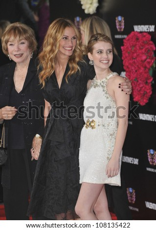 """LOS ANGELES, CA - FEBRUARY 8, 2010: Shirley MacLaine (left), Julia Roberts & Emma Roberts at the world premiere of their new movie """"Valentine's Day"""" at Grauman's Chinese Theatre, Hollywood. - stock photo"""