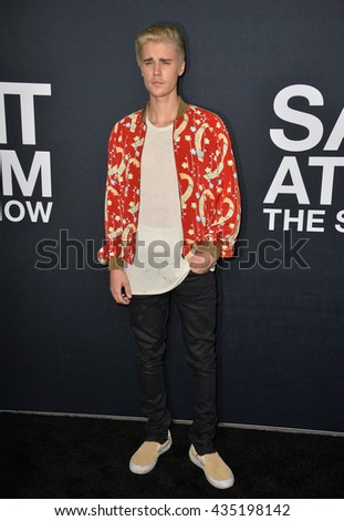 LOS ANGELES, CA - FEBRUARY 10, 2016: Singer Justin Bieber arriving at the Saint Laurent at the Palladium fashion show at the Hollywood Palladium. - stock photo