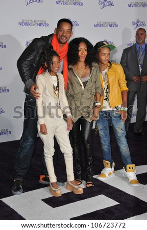"LOS ANGELES, CA - FEBRUARY 8, 2011: Will Smith & wife Jada Pinkett Smith & children Jaden & Willow at the premiere of ""Justin Bieber: Never Say Never"" at the Nokia Theatre LA Live. - stock photo"