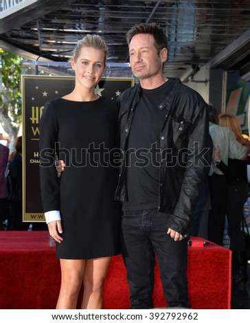 LOS ANGELES, CA - JANUARY 25, 2016: Actor David Duchovny & actress Claire Hoult on Hollywood Boulevard where he was honored with the 2,572nd star on the Hollywood Walk of Fame. - stock photo