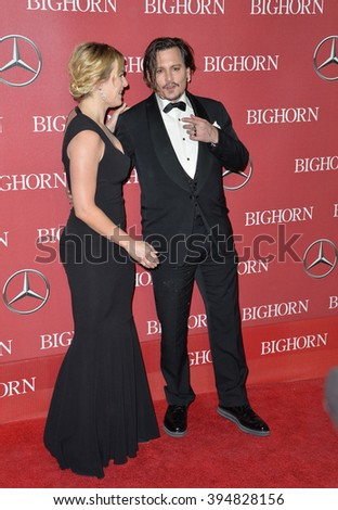 LOS ANGELES, CA - JANUARY 2, 2016: Actress Kate Winslet & actor Johnny Depp at the 2016 Palm Springs International Film Festival Awards Gala - stock photo