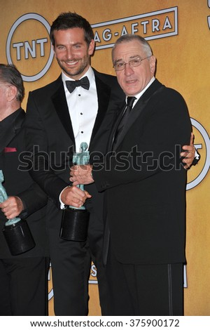LOS ANGELES, CA - JANUARY 18, 2014: Bradley Cooper & Robert De Niro at the 20th Annual Screen Actors Guild Awards at the Shrine Auditorium.