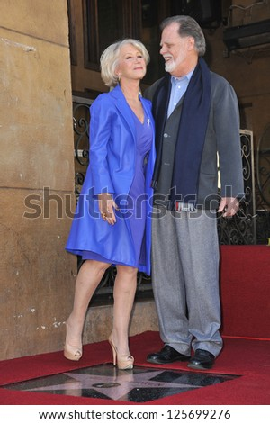 LOS ANGELES, CA - JANUARY 3, 2013: Dame Helen Mirren & husband Taylor Hackford on Hollywood Boulevard where she was honored with the 2,488th star on the Hollywood Walk of Fame. - stock photo