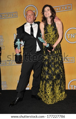 LOS ANGELES, CA - JANUARY 18, 2014: Dean Norris & Betsy Brandt at the 20th Annual Screen Actors Guild Awards at the Shrine Auditorium.  - stock photo