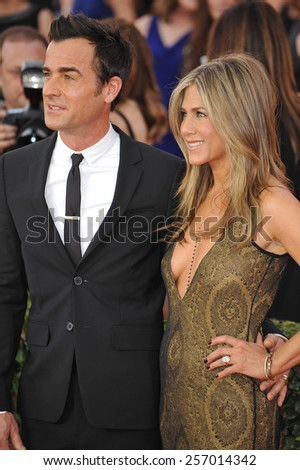 LOS ANGELES, CA - JANUARY 25, 2015: Jennifer Aniston & Justin Theroux at the 2015 Screen Actors Guild  Awards at the Shrine Auditorium.  - stock photo