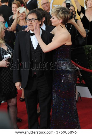 LOS ANGELES, CA - JANUARY 18, 2014: Jennifer Lawrence & director David O. Russell at the 20th Annual Screen Actors Guild Awards at the Shrine Auditorium. - stock photo