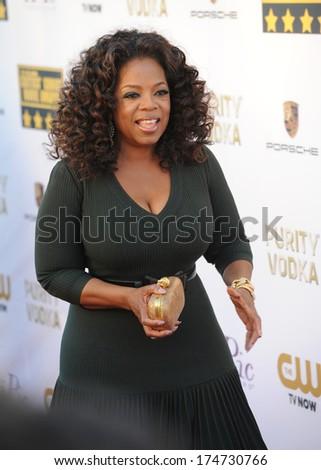 LOS ANGELES, CA - JANUARY 16, 2014: Oprah Winfrey at the 19th Annual Critics' Choice Awards at The Barker Hangar, Santa Monica Airport.  - stock photo