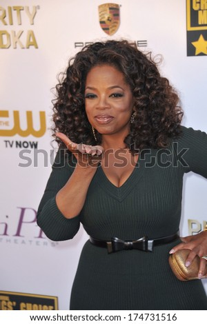 LOS ANGELES, CA - JANUARY 16, 2014: Oprah Winfrey at the 19th Annual Critics' Choice Awards at The Barker Hangar, Santa Monica Airport.  - stock photo