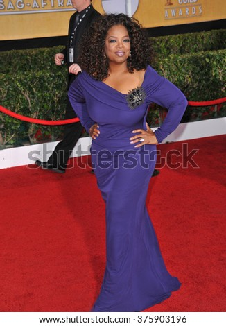 LOS ANGELES, CA - JANUARY 18, 2014: Oprah Winfrey at the 20th Annual Screen Actors Guild Awards at the Shrine Auditorium.