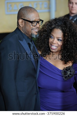 LOS ANGELES, CA - JANUARY 18, 2014: Oprah Winfrey & Forest Whitaker at the 20th Annual Screen Actors Guild Awards at the Shrine Auditorium.