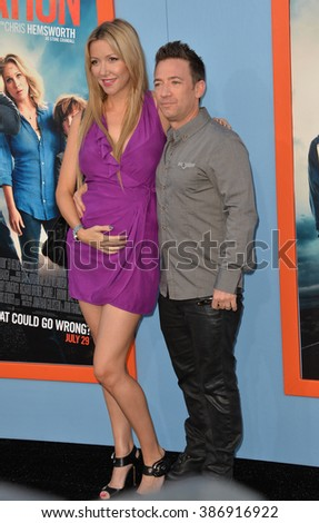 "LOS ANGELES, CA - JULY 27, 2015: David Faustino & girlfriend Lindsay Bronson at the premiere of ""Vacation"" at the Regency Village Theatre, Westwood."