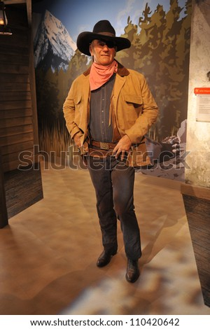 LOS ANGELES, CA - JULY 21, 2009: John Wayne waxwork figure - grand opening of Madame Tussauds Hollywood. - stock photo