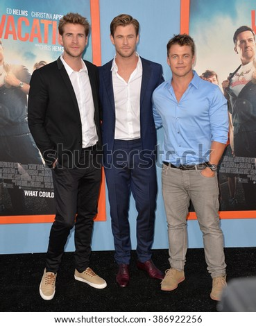 "LOS ANGELES, CA - JULY 27, 2015: Liam Hemsworth (left), Chris Hemsworth & Luke Hemsworth at the premiere of Chris Hemsworth's movie ""Vacation"" at the Regency Village Theatre, Westwood."