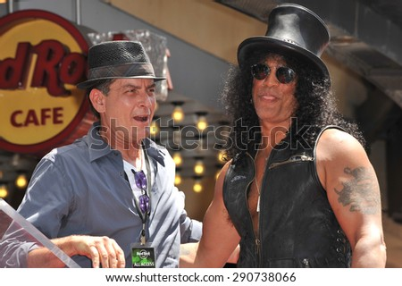 LOS ANGELES, CA - JULY 10, 2012: Rock guitarist Slash & actor Charlie Sheen on Hollywood Blvd where he was honored with a star on the Hollywood Walk of Fame. - stock photo