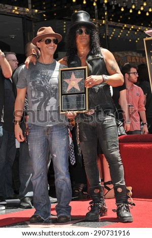 LOS ANGELES, CA - JULY 10, 2012: Rock guitarist Slash & actor Clifton Collins Jr on Hollywood Blvd where he was honored with a star on the Hollywood Walk of Fame. - stock photo