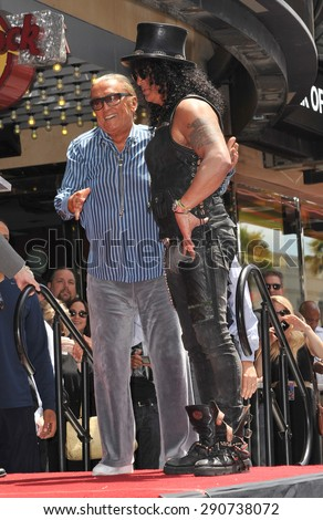 LOS ANGELES, CA - JULY 10, 2012: Rock guitarist Slash & producer Robert Evans on Hollywood Blvd where he was honored with a star on the Hollywood Walk of Fame. - stock photo