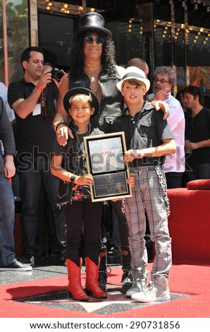 LOS ANGELES, CA - JULY 10, 2012: Rock guitarist Slash & sons on Hollywood Blvd where he was honored with a star on the Hollywood Walk of Fame. - stock photo