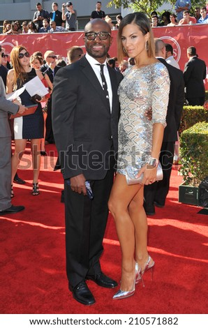 LOS ANGELES, CA - JULY 16, 2014: Taye Diggs & Amanza Smith Brown at the 2014 ESPY Awards at the Nokia Theatre LA Live.  - stock photo
