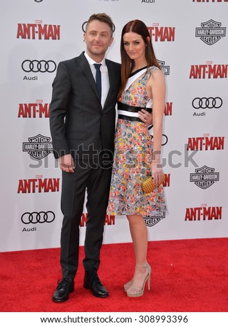 "LOS ANGELES, CA - JUNE 29, 2015: Actor Chris Hardwick & actress Lydia Hearst at the world premiere of ""Ant-Man"" at the Dolby Theatre, Hollywood.  - stock photo"