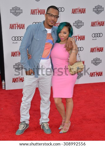 """LOS ANGELES, CA - JUNE 29, 2015: Actor Tip """"T.I"""" Harris & wife Tameka 'Tiny' Cottle at the world premiere of his movie """"Ant-Man"""" at the Dolby Theatre, Hollywood.  - stock photo"""