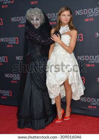 LOS ANGELES, CA - JUNE 5, 2015: Actress Stefanie Scott & The Black Bride at the world premiere of their movie Insidious Chapter 3 at the TCL Chinese Theatre, Hollywood.  - stock photo