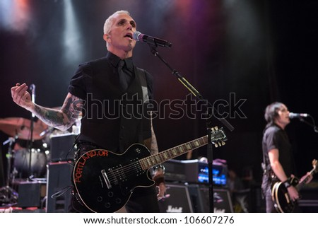 LOS ANGELES, CA - JUNE 29: Art Alexakis of Everclear performs to a sold-out crowd at first annual Summerland tour at the Greek Theatre on June 29, 2012 in Los Angeles, CA. - stock photo