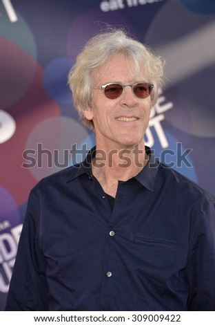 """LOS ANGELES, CA - JUNE 9, 2015: Composer Stewart Copeland at the Los Angeles premiere of Disney-Pixar's """"Inside Out"""" at the El Capitan Theatre, Hollywood.  - stock photo"""