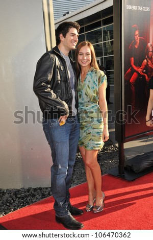 "LOS ANGELES, CA - JUNE 21, 2011: Courtney Ford & husband Brandon Routh at the premiere of the fourth season of HBO's ""True Blood"" at the Cinerama Dome, Hollywood. June 21, 2011  Los Angeles, CA - stock photo"