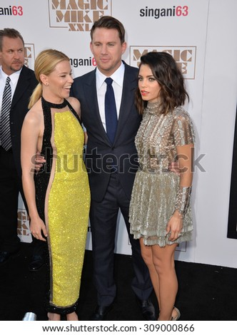 "LOS ANGELES, CA - JUNE 25, 2015: Elizabeth Banks (left) with Channing Tatum & wife Jenna Dewan Tatum at the world premiere of their movie ""Magic Mike XXL"" at the TCL Chinese Theatre, Hollywood.  - stock photo"