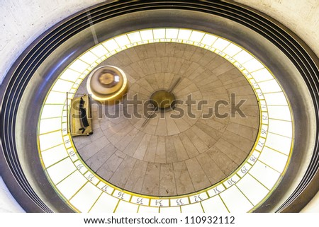 LOS ANGELES, CA - JUNE 10: Foucault pendulum in Griffith park on June 10,2912 in Los Angeles. The pendulum was installed in 1935 to demonstrate the rotation of the Earth.