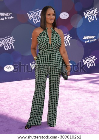"""LOS ANGELES, CA - JUNE 9, 2015: Garcelle Beauvais at the Los Angeles premiere of Disney-Pixar's """"Inside Out"""" at the El Capitan Theatre, Hollywood.  - stock photo"""