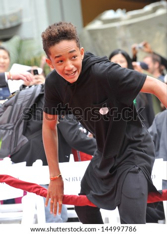 LOS ANGELES, CA - JUNE 6, 2013: Jaden Smith, son of Will Smith & Jada Pinkett Smith, at Jackie Chan's hand & footprint ceremony in the courtyard of the TCL Chinese Theatre, Hollywood.  - stock photo
