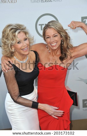 LOS ANGELES, CA - JUNE 5, 2014: Jane Fonda (left) with author & firness instructor Denise Austin at the 2014 AFI's Life Achievement Awards honoring Jane Fonda, at the Dolby Theatre, Hollywood.  - stock photo
