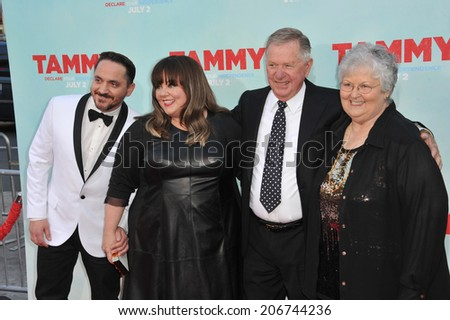 "LOS ANGELES, CA - JUNE 30, 2014: Melissa McCarthy & husband Ben Falcone & her parents at the premiere of her movie ""Tammy"" at the TCL Chinese Theatre, Hollywood.  - stock photo"