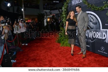 "LOS ANGELES, CA - JUNE 10, 2015: Sofia Vergara & Joe Manganiello at the world premiere of ""Jurassic World"" at the Dolby Theatre, Hollywood. - stock photo"