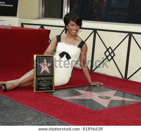 LOS ANGELES, CA - MAR 20: Actress Angela Bassett receives a star on the Hollywood Walk of Fame in Los Angeles, California on March 20, 2008 - stock photo