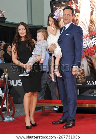 LOS ANGELES, CA - MARCH 4, 2015: Actor Vince Vaughn & wife Kyla Weber & children Vernon & Lochlan at the TCL Chinese Theatre, Hollywood, where he had his hand and footprints set in cement.  - stock photo