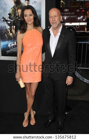 """LOS ANGELES, CA - MARCH 28, 2013: Bruce Willis & Emma Heming at the Los Angeles premiere of his movie """"G.I. Joe: Retaliation"""" at the Chinese Theatre, Hollywood. - stock photo"""