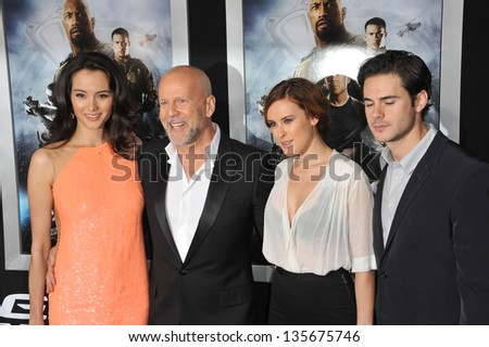 """LOS ANGELES, CA - MARCH 28, 2013: Bruce Willis & Emma Heming (left) & his daughter Rumer Willis & Jayson Blair at the Los Angeles premiere of his movie """"G.I. Joe: Retaliation"""" at the Chinese Theatre. - stock photo"""