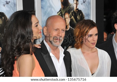 """LOS ANGELES, CA - MARCH 28, 2013: Bruce Willis & Emma Heming (left) & his daughter Rumer Willis at the Los Angeles premiere of his movie """"G.I. Joe: Retaliation"""" at the Chinese Theatre, Hollywood. - stock photo"""