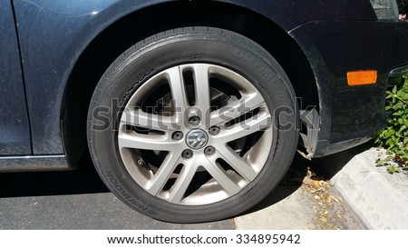 LOS ANGELES, CA - MARCH 5, 2015: Extremely bad condition of rubber surface showing deep cracks in Hankook Optimo tire mounted on a front Volkswagen wheel. Label on the tire reads Made in China.